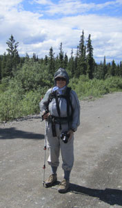 Okay, my pointed stick is a hiking pole... and I don't have a bag, but it's a funny photo of the gitty-up we wore to hike among the mosquitoes a few years ago in Alaska.